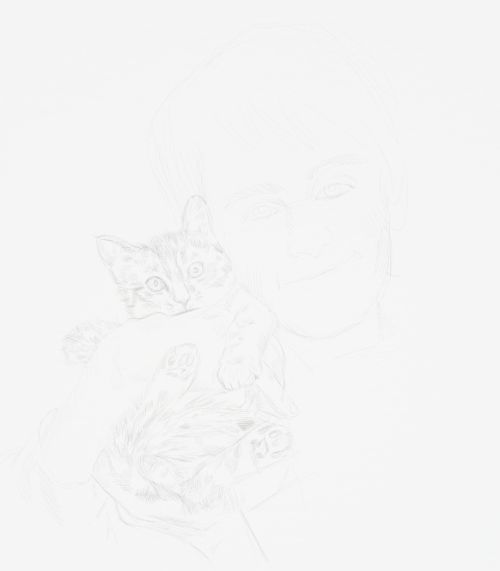 kitten drawing. Boy holding a cat.